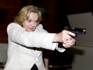 081111. Photo Maarten Holl/Fairfax Media, The Dominion Post. NEWS. Police College. New firearms, etc, training simulator. minister of Police Judith Collins gets trained by Vince Anthony, Lockheed Martin (US)