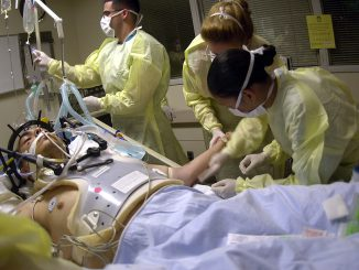 040723-N-8977L-008 Los Angeles, Calif. (July 23, 2004) - Navy Hospital Corpsmen and Medical Officers assess the treatment and prognosis of a patient with a gunshot wound to the head in the Intensive Care Unit (ICU) at the Los Angeles County, University of Southern California (USC) Medical Center. The students are part of an outreach cooperative training program between Navy Medicine and the medical center. The Naval Trauma Training CenterÕs (NTTC) mission is to provide trauma experience and knowledge to Naval medical personnel before they deploy. The students from Naval Hospitals, clinics and commands at Naval Installations around the world, work in the emergency room, operating room and intensive care unit, to learn about the wide range of situations they may encounter when sent into the field. U.S. Navy photo by PhotographerÕs Mate 2nd Class Johansen Laurel (RELEASED)